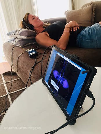woman sleeping during neuroptimal neurofeedback session