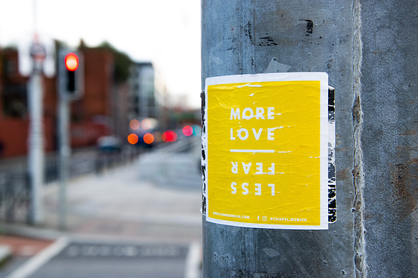 more-love-less-fear-sticker-on-post-unsplash-photo