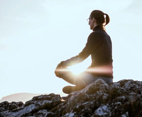 woman-meditating-outdoors