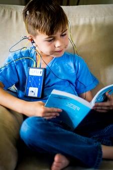 20170707 Neuroptimal Stock 252-child-reading-during-neurofeedback-session