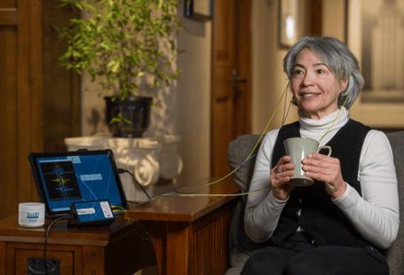 woman drinking tea during a neuroptimal brain training session