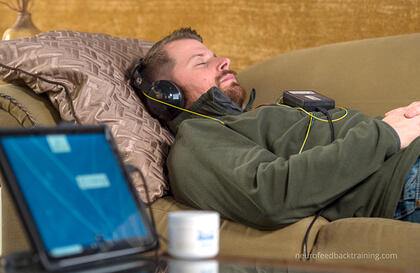 man relaxing during a Neuroptimal Neurofeedback home session