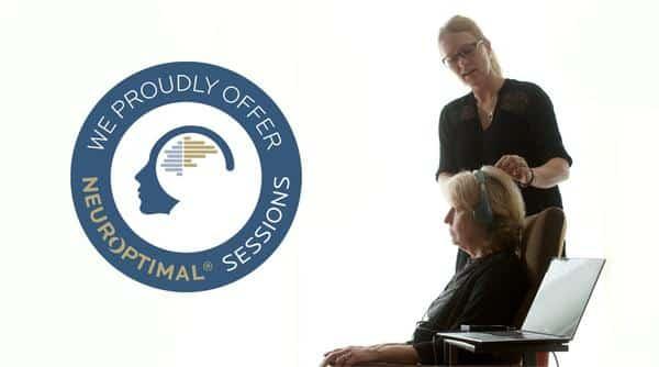 neurofeedback trainer setting up a neuroptimal session