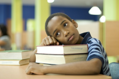 boy with books at school