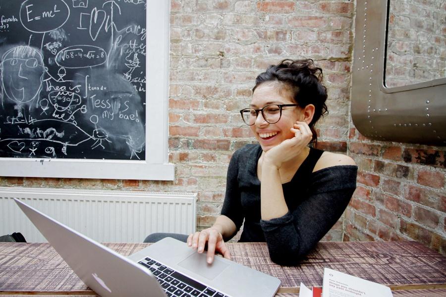 ellyot-588064-unsplash-woman-at-workplace
