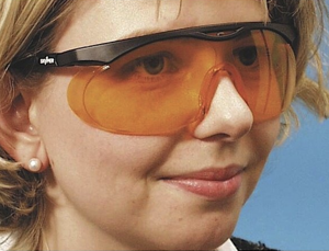 woman wearing orange glasses for night